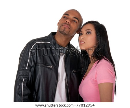 Young couple looking into the future - African American guy with Asian girlfriend. - stock photo