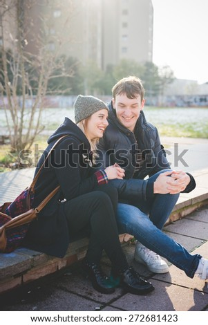 young couple lovers authentic in the city - stock photo