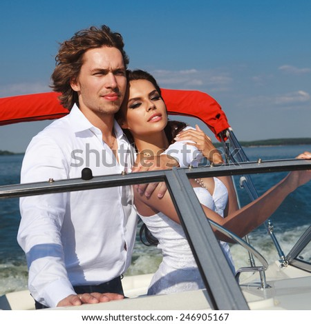 Young couple loving each other. Young family on a sea voyage on a yacht. - stock photo