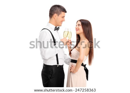 Young couple making a toast with wine isolated on white background  - stock photo