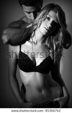 young couple making out - stock photo