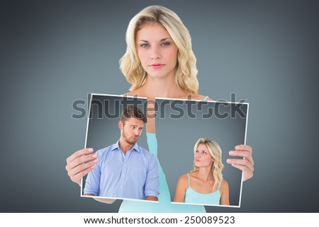 Young couple making silly faces against grey vignette - stock photo