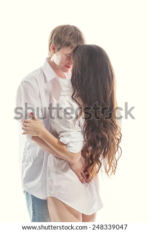 Young couple man and woman gently and passionately embracing each other - stock photo