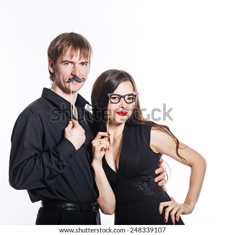 Young couple man and woman gently and passionately embracing each other. Play about and flirting with each other - stock photo