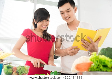 Young couple mastering their culinary skills - stock photo