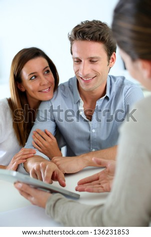Young couple meeting financial adviser - stock photo