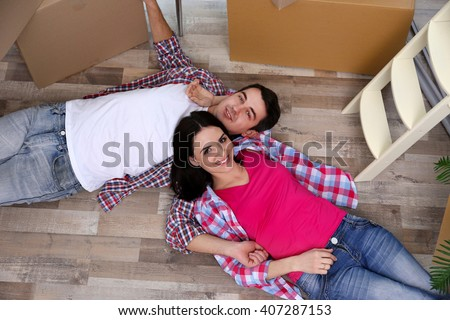 Young couple moving in new house. Top view. - stock photo