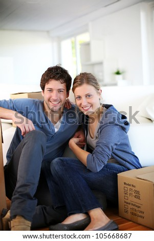 Young couple moving in their home - stock photo
