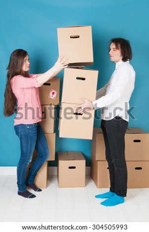 Young couple moving into a new house - stock photo