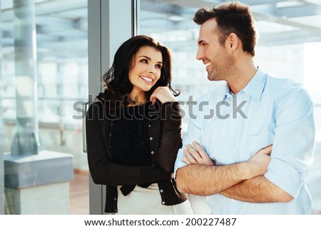 Young couple of professionals having a conversation - stock photo