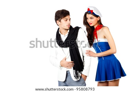 Young couple of sensual young woman flirting with elegant confident man. Isolated on white background. High resolution studio image - stock photo
