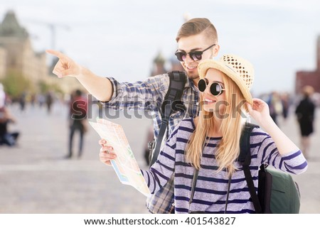 Young couple of travelers in the city, outdoors - stock photo