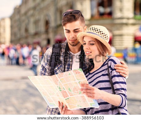 Young couple of travelers on the city background - stock photo