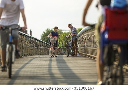 Young couple on a bikes ride in the city. - stock photo