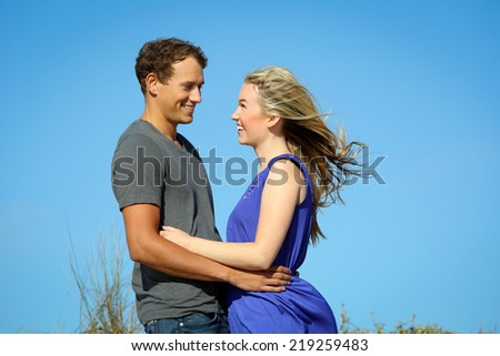 Young couple on a breezy day - stock photo