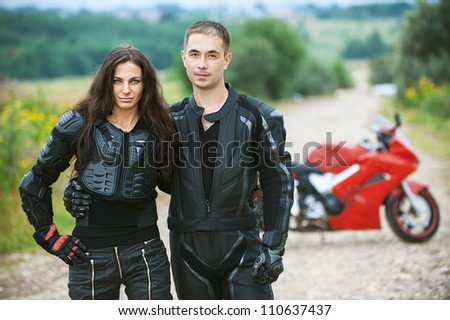 Young couple on background of beautiful bike. - stock photo