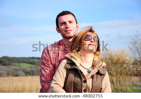 young couple on nature - stock photo