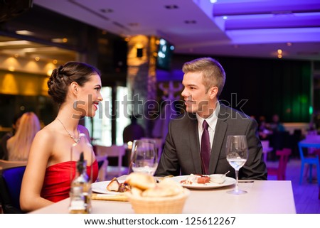 Young couple on romantic diner - stock photo