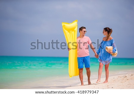 Young couple on white beach at summer vacation - stock photo