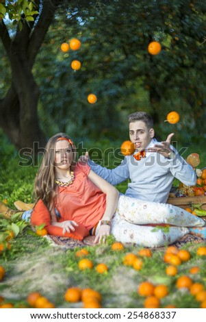 young couple outdoor in orange orchard - stock photo