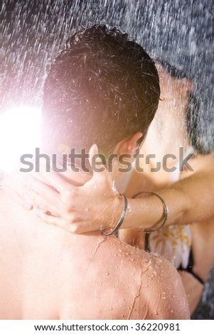 Young couple passion. Water studio photo. - stock photo