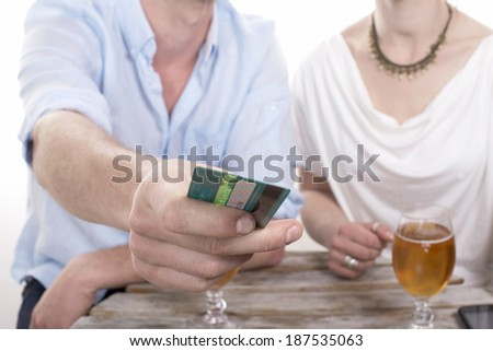 young couple pays the bill with a credit card - stock photo