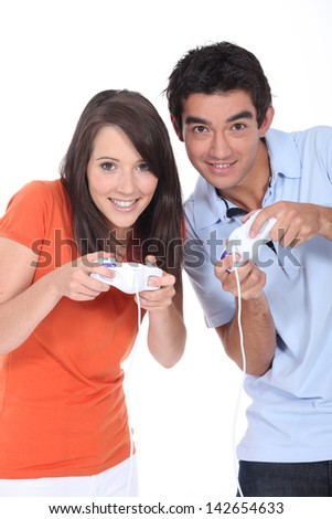 Young couple playing a video game - stock photo