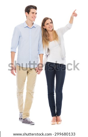 Young couple pointing - stock photo