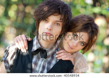 Young couple portrait. Focus on male face. - stock photo