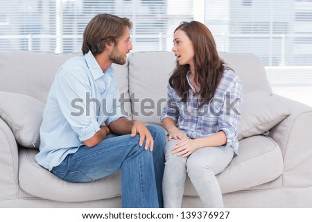 Young couple quarreling in the office of therapist - stock photo