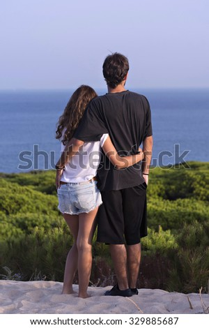 Young couple relaxing by the beach - stock photo