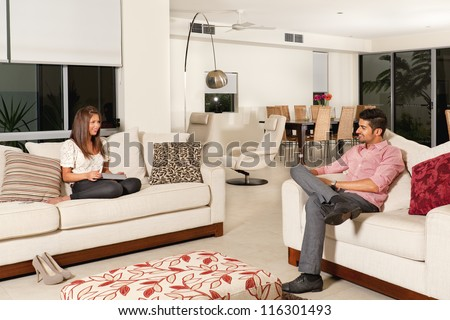 Young couple relaxing in modern living room. - stock photo