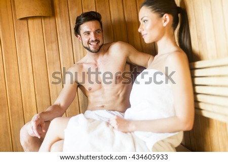 Young couple relaxing in the sauna in spa center - stock photo
