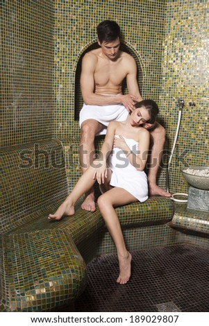 Young couple relaxing in Turkish bath - stock photo