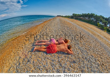 Young Couple Relaxing on a Skala Beach in Kefalonia, Greece - stock photo