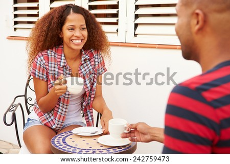 Young Couple Relaxing Outdoors And Drinking Coffee - stock photo