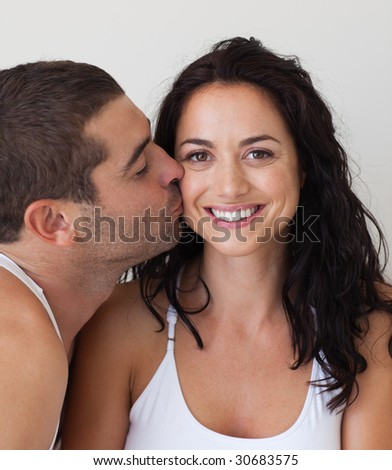 Young Couple relaxing together at home - stock photo