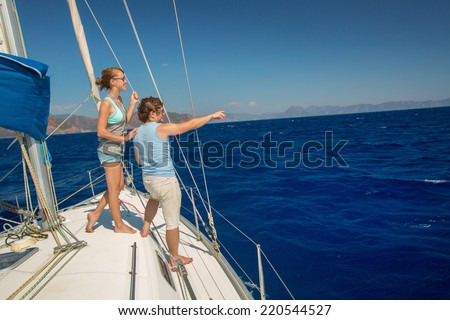 Young couple sailing in a sea - stock photo