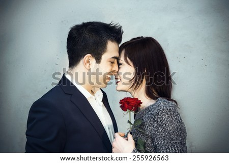 Young couple sharing a tender moment together - stock photo