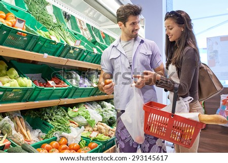 Young couple shopping in a supermarket - stock photo