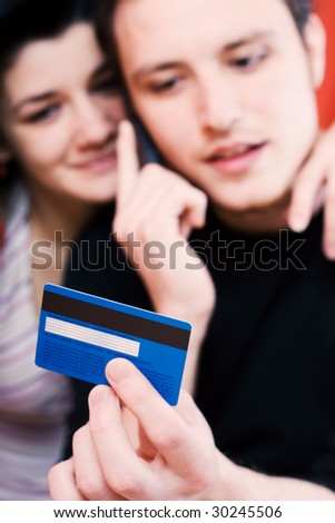 Young couple shopping on the phone - stock photo