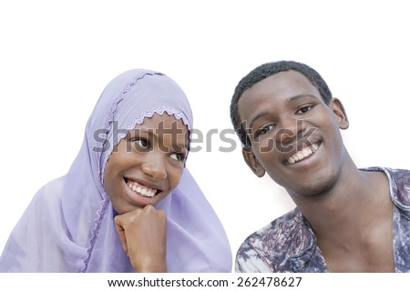 Young couple showing a beautiful complicity, isolated  - stock photo