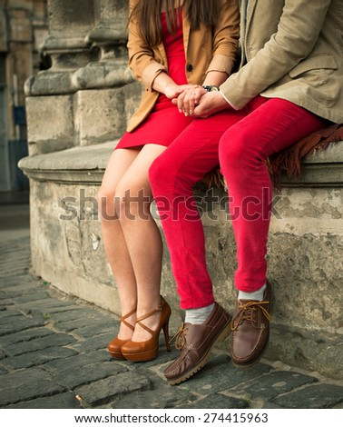 Young couple sitting  in summer - stock photo