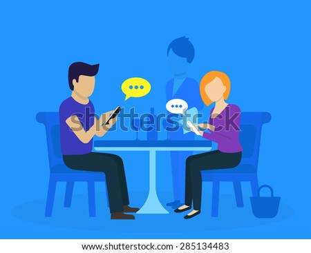 Young couple sitting in the restaurant and using smartphones for social networks - stock photo