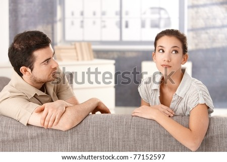 Young couple sitting on sofa at home in bad mood after quarrelling.? - stock photo