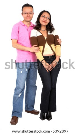 young couple smiling and standing next to each other - isolated over a white background - stock photo