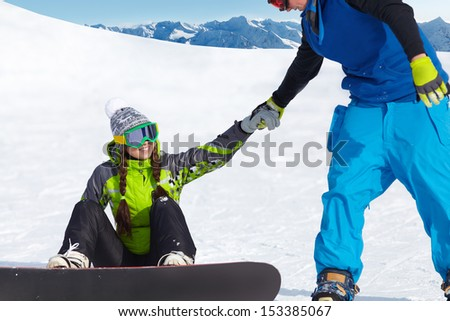Young couple snowboarders in a ski resort - stock photo