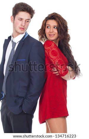 Young couple standing back to back - stock photo