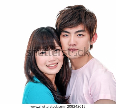 Young couple standing together  - stock photo