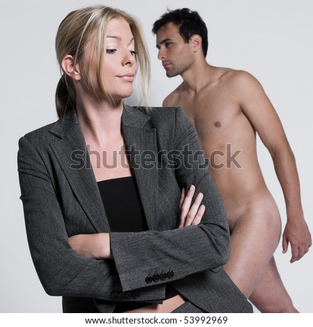 young couple sullen with man naked in studio on isolated grey background - stock photo